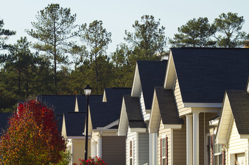 Fall afternoon in a typical middle class, southern American residential subdivision of homes that are built close together to maximize the land use by the developer and reduce the price of each home. Each home shares a similar contemporary build style with only minor paint or plan changes on the outside and inside. This subdivision is in South Carolina, USA.
