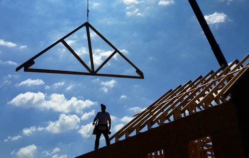 new-construction-home-house-worker-frame