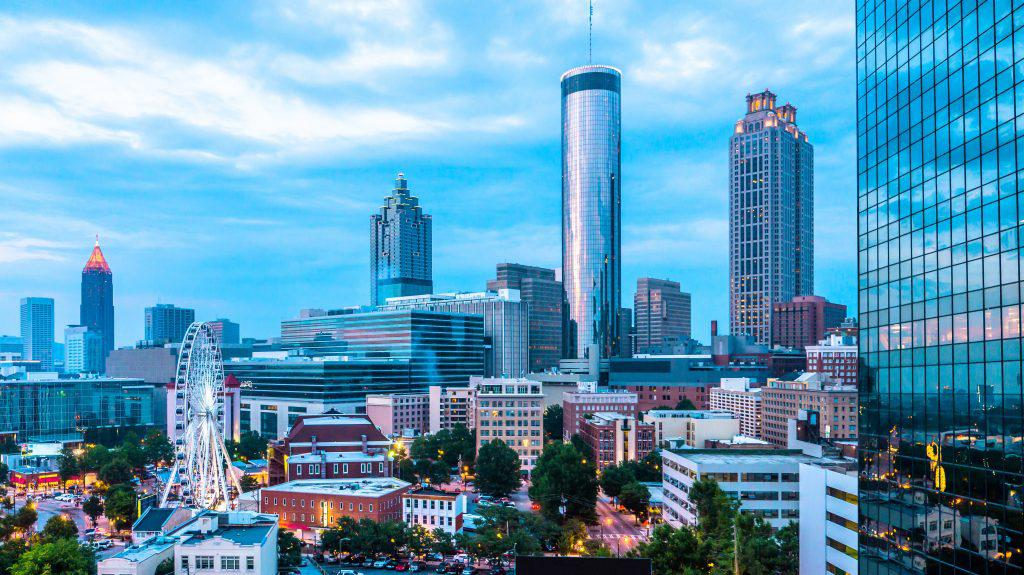 Skyline view of Downtown and Midtown Atlanta with ferris wheel from a rooftop bar and lounge